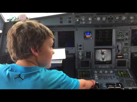 Kid checking out Thai Airlines cockpit