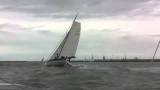 Trimaran Dragonfly 32 overtaking a fast 50' monohull