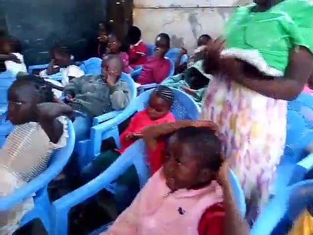 GMFC Kibera Slum Church Kenya Pastor Joseph Preaching to Children
