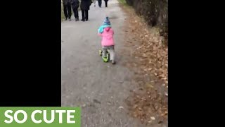Baby already rides scooter like a pro!