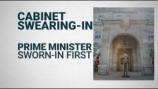 How does a cabinet swearing-in work?