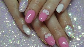 Baby pink acrylic nails with 3d acrylic bow