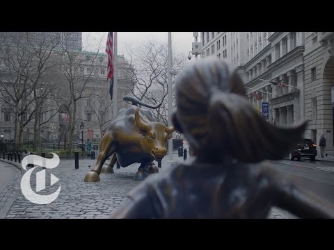 Statue of Courageous Girl Faces Wall Street Bull | The New York Times