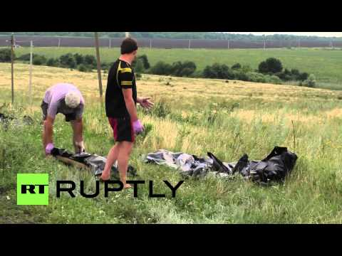 Ukraine: Dead bodies of MH17 victims moved from crash site *GRAPHIC*