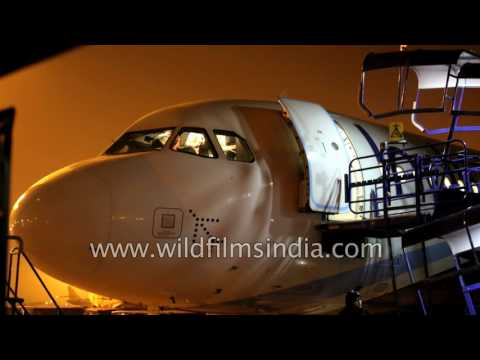 Pilot preps Indigo plane for departure from Delhi