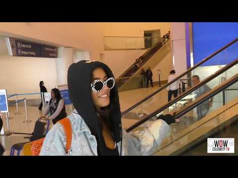 madison beer talks about if she is dating brooklyn beckham while departing at lax airport in los ang