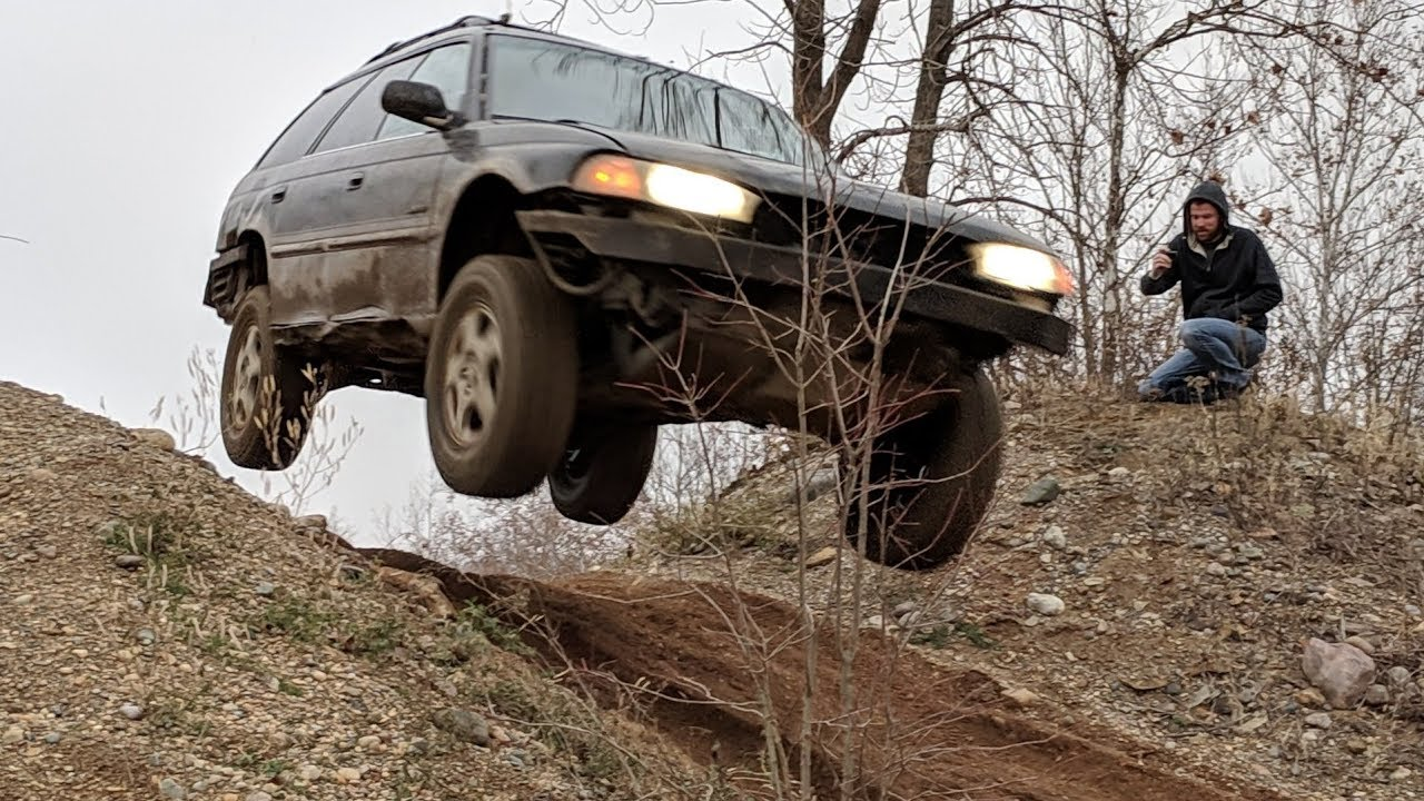 Subaru Outback and Forester with long travel suspension struts jumping at  Badlands