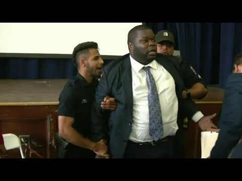 Detroit police commissioner removed from meeting in handcuffs, arrested