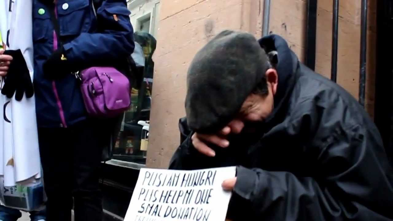 Anonymous makes homeless man cry. - YouTube