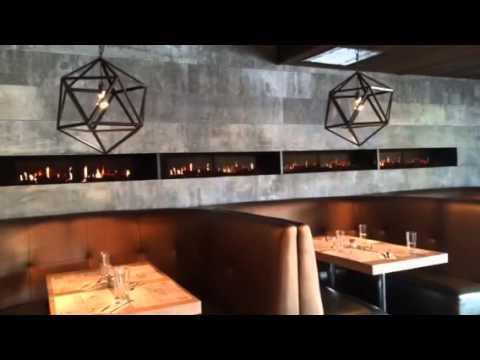 Необычная инсталляция электрокамина Dimplex Opti-V 2 в ресторане Квебека