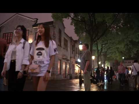 People watching in Xintiandi, Shanghai, China - street fashion and street life 4K background video