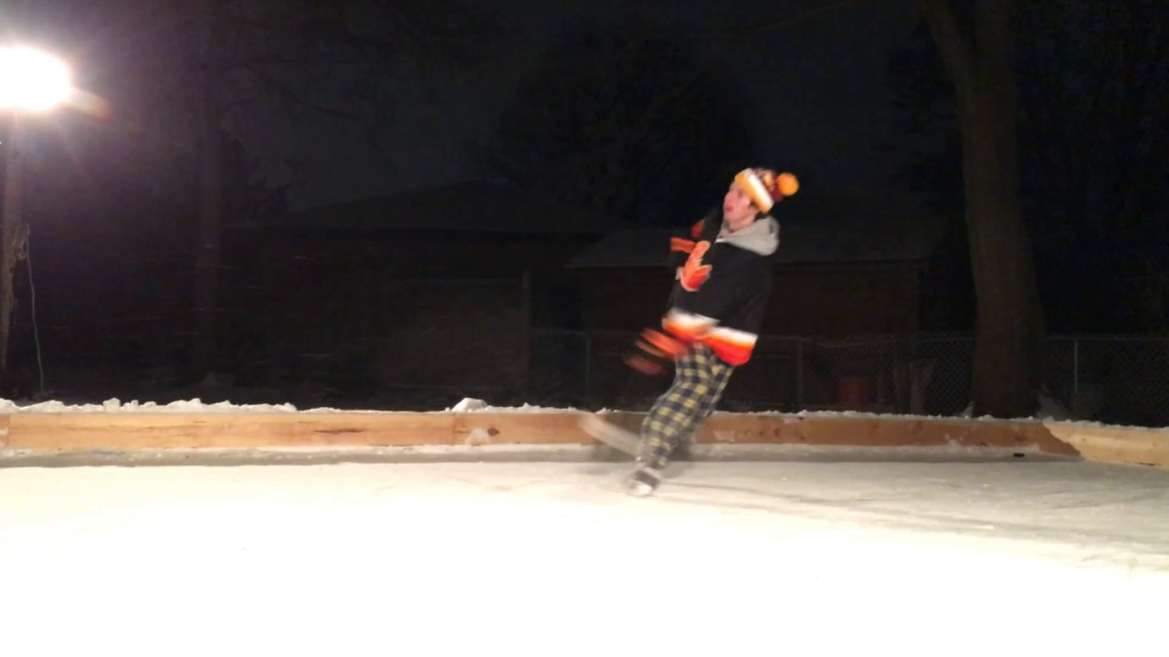 brandon jensen practicing his shot on homemade backyard ice rink