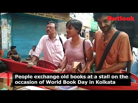 People exchange old books at a stall on the occasion of World Book Day in Kolkata