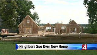 Neighbors sue over new home