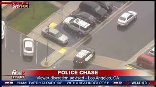 FULL POLICE CHASE: Woman in custody after chase on wet Los Angeles streets (FNN)