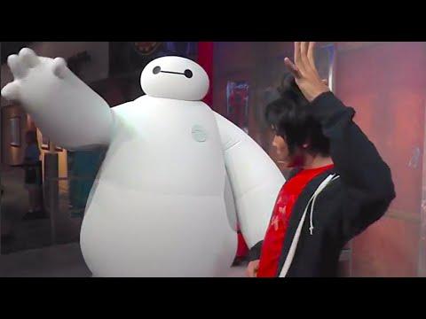 Baymax & Hiro fist bump in Big Hero 6 meet and greet at Walt Disney World