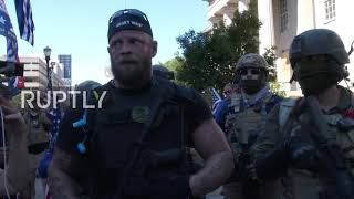 USA: Armed militia members face off BLM protesters in Louisville