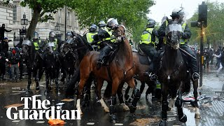 Mounted police charge into protesters at London anti-racism demonstration