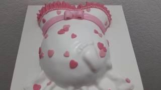Babybauch-Torte in rosa und weiß/Französische Buttercreme