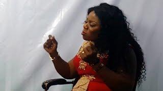 Anapa Bosuo close up with Piesie Esther on ATV