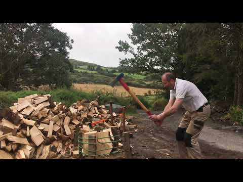 Splitting firewood: knotty difficult rounds with twisted grain.