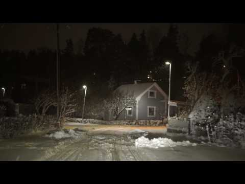 Sweden, Stockholm, Huddinge, early morning drive in snowy residential area