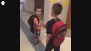 Kindergarten class starts every morning with a handshake chain