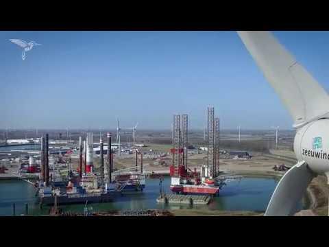 Mooie drone beelden van offshore haven en windturbine bij oppervlakte meting depot
