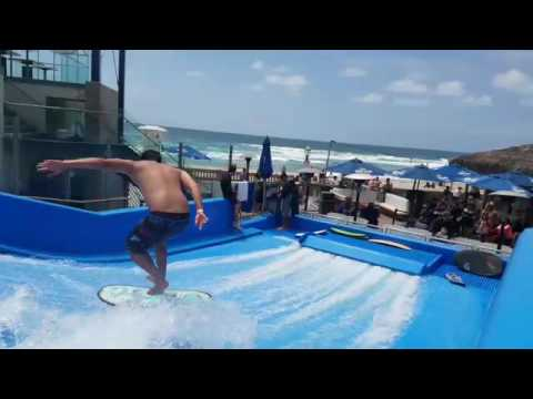 Nick Nguyen on the Flowrider at wave House San Diego