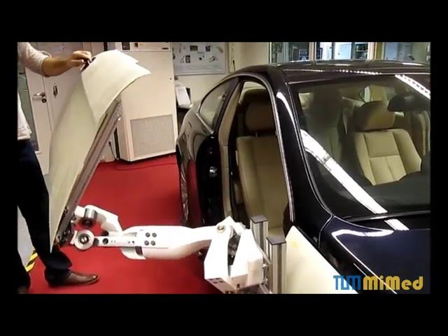 TUM MiMed: Origami-Inspired Design of a Spatial Car Door Guidance Linkage