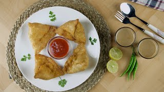 Overhead shot of beautifully plated samosas with tomato ketchup - Indian street food
