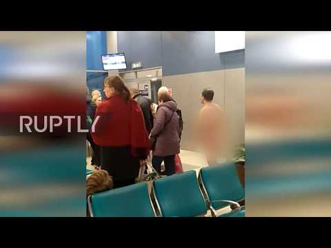 None - Flight of fantasy! NAKED man tries to board plane at Moscow airport