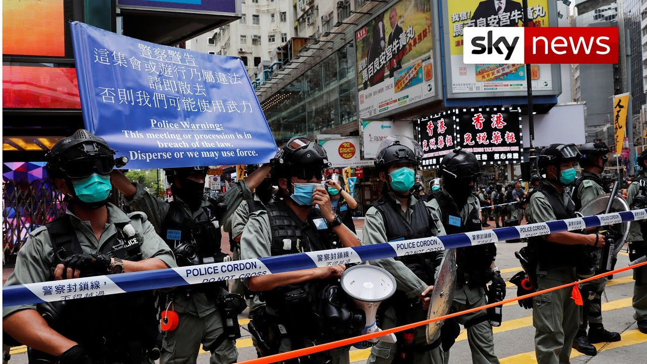 Arrest as China enacts tough Hong Kong security law
