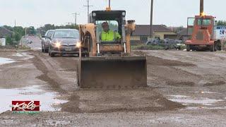Drivers Maneuver Through Flooded Roads