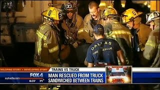 Driver survives crash with train