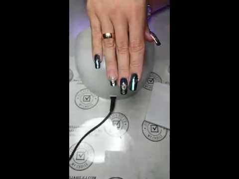 Павлинье перо на ногтях
