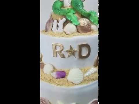 under-the-sea-wedding-cake,-with-fondant-mermaids