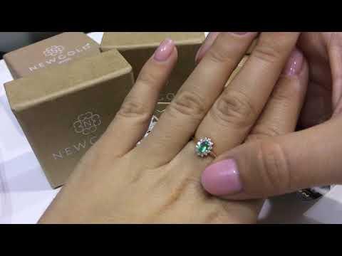 Кольцо 126 из красного золота 585 пробы с изумрудом и бриллиантами