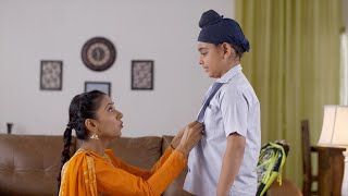 Young mother helping her son to get ready for school - Indian Family. Love, Family Concept