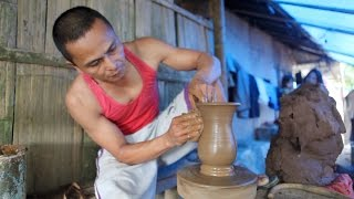 Potter making a vase of clay at Pulutan Pottery Training Centre