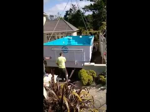 Hiab transport place a spa pool at River Head Auckland