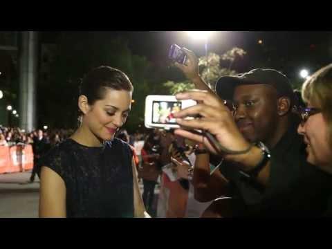 Blood Ties: Marion Cotillard arrives at TIFF premiere