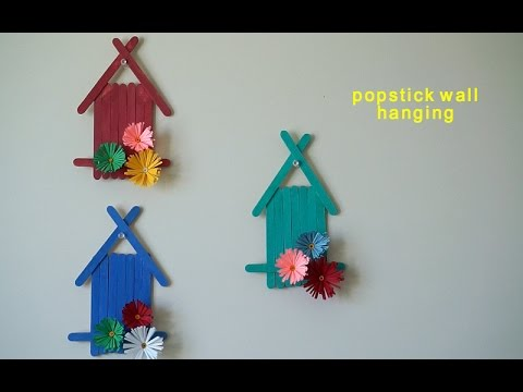 popsicle sticks wall hanging with handmade paper flower