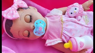 Dominika play with baby doll feed the doll