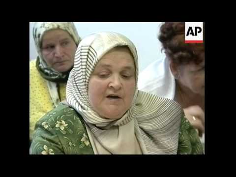 Mothers of Srebrenica watch Karadzic in the war crimes dock