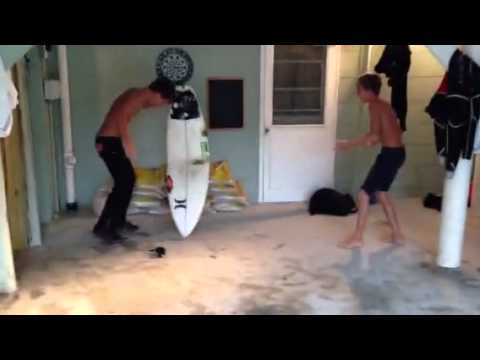 Kid snaps surfboard after prank