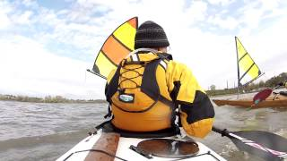 Aft view of kayaker using a Falcon Sail on a Epic 18x Sport in moderate wind Thumbnail
