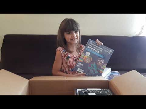 Hannah opens her 2nd grade supply kit from River Springs Charter School