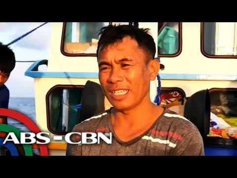 Fish for alcohol, noodles: Filipino fishermen barter with Chinese at sea