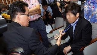 국정원 직원 청문회장에서 야당 의원 도촬 파문